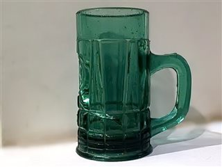 Mug for beer. Side view.